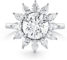 Round and Classic Pear Shape Halo diamonds. A vintage look inspired by the 1930's. This is definitely a unique diamond that will be the envy of your friends. At PureDiamond.ca we have unparalleled friendly service. If you're in the Greater Vancouver area please call (604) 563-9875 to book an appointment.
