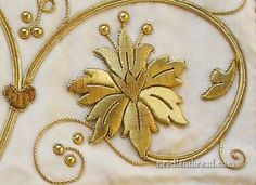 Raised Goldwork Embroidery worked over a card (board) foundation