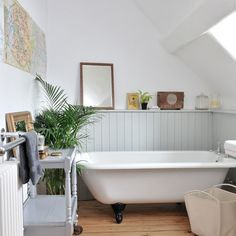 A freestanding bath and painted tongue and groove panelling on the walls makes for a perfect country bathroom scheme.