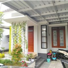 Teras Depan Rumah Minimalis Modern 1 Lantai carport covers houston txGone are the days when decorating was a one-and-done deal. These days's. Home Room Design, Small House Design, Exterior House Colors, Exterior Design, House Plants Decor, Entrance Design, Modern Patio, Monochrom, Patio Roof