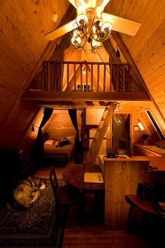 A Tiny Cabin. Perfect...even down to the warm glow and Husky I want :)