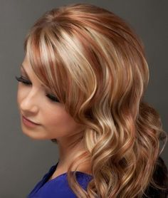 Long Wavy Hairstyle with Red Highlights.
