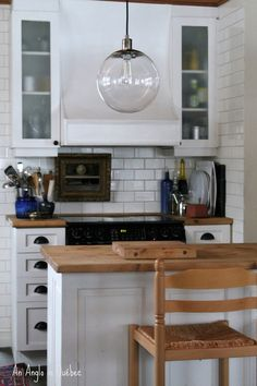 Globe Pendant Light from west elm in a kitchen