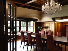 CS - You don't have to paint. When done right, natural, rich woodwork is beautiful too. I love this wooden french door, sparkling chandelier and long wooden dining table.