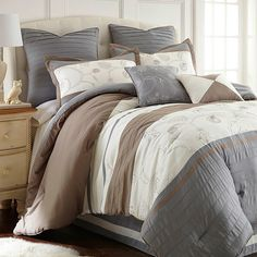 Awash in cool, earthy hues, this lovely comforter set lends a touch of understated elegance to your master suite or guest room.   P...
