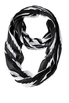 The Navy Ikat fabric is off-white with navy. You will love the way the ikat design looks when you wear this scarf.  https://www.uptowncasual.com/products/navy-ikat-infinity-scarf #infinityscarf #uptownscarves #scarves