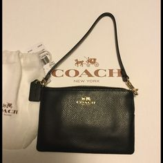 """COACH corner zip wristlet in gift box It's great for a night out with minimal baggage! Holds some cash, your phone, lipstick, and a couple of credit cards!!Coach black corner zip wristlet in crossgrain leather.  Black crossgrain leather Two credit card pockets Zip closure, fabric lining Strap with clip to form a wrist strap or attach to the inside of a bag.  6 1/4"""" (L) x 4"""" (H) Fits an iPhone or Android. Please measure your phone first depending on the style/make of phoneIn Coach gift pouch…"""