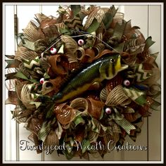 Perfect for Lake House, Sportsman, Father's Day. Complete with fish, fishing ribbon, fishing rod, floaters, and lures.  Created by Twentycoats Wreath Creations (2016)