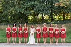 The red bridesmaids dresses make the bride pop! BEE MINE PHOTOGRAPHY // Canton, Ohio Photographer // Akron Ohio Wedding, Hilton Akron Wedding, Hotel Wedding, Fall Wedding, Gold Cranberry and Peach Wedding