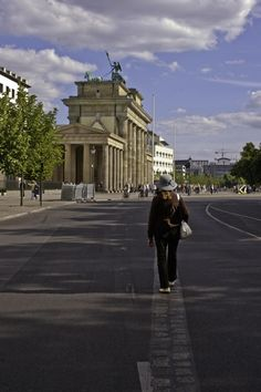 Walking on the foundation of the former Berlin Wall toward the Brandenburg Gate; former East Germany