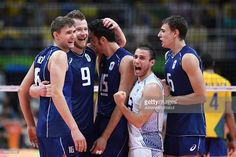 Italy's Oleg Antonov, Italy's Ivan Zaytsev, Italy's Emanuele Birarelli, Italy's Massimo Colaci and Italy's Simone Giannelli celebrate after scoring during the men's Gold Medal volleyball match between Italy and Brazil at the Maracanazinho stadium in Rio de Janeiro on August 21, 2016, at the Rio 2016 Olympic Games. / AFP / Johannes EISELE