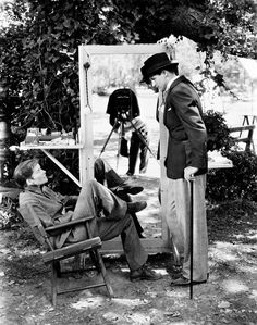 ✯ Actors Cary Grant (1904 - 1986) and Katharine Hepburn (1907 - 2003) ✯ on the set of 'Sylvia Scarlett', directed by George Cukor, California, 1935. Photographer Alex Kahle can be seen at work in the mirror (centre). (Photo by Alex Kahle)
