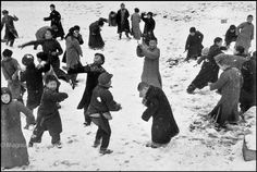 Snowball fight in China, 1938. by Robert Capa