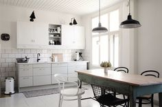 Black and white kitchen with brass details