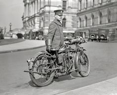 A Washington, DC police officer with his Indian Powerplus motorcycle in 1924. The Powerplus has clearly seen better days; notice that this is a very early example of rear wheel suspension using, in typical Indian fashion, leaf springs.
