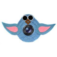 Máscara para câmera em formato de passarinho e medindo 30 x 16 cm (largura x altura). Ela é colocada na lente de câmeras fotográficas para chamarem a atenção de bebês e crianças na hora de fotografá-los.  Feita em crochê com linha de algodão e detalhes em feltro, a máscara possui um elástico que permite que seja colocada em lentes com 19 a 22 cm de circunferência.   Produto feito à mão. R$ 30,00
