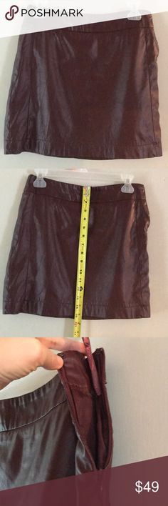 The Limited burgundy faux leather mini skirt Super cute burgundy faux leather skirt from The Limited size 0. One tiny nick in the fabric indicated in the last photo with my pinky pointing to it. Barely noticeable and could be covered up with a brown or burgundy sharpie. The Limited Skirts Mini