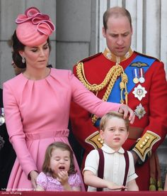 Catherine, Duchess of Cambridge, Princess Charlotte of Cambridge, Prince George of Cambridge and Prince William, Duke of Cambridge look out from the balcony of Buckingham Palace during the Trooping the Colour parade on June 17, 2017 in London.
