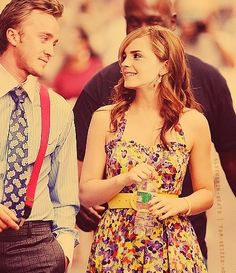 the look on Tom's face in this picture.... dead... seriously... // Tom Felton and Emma Watson (seriously, if they ever dated that would make me soooo happy)