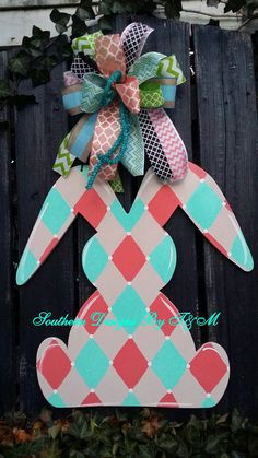 Check out this item in my Etsy shop https://www.etsy.com/listing/223339460/harlequin-coralaqua-bunny-door-hanger
