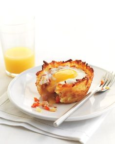 Denver Omelet Cups - Martha Stewart Recipes.  With ham, hashbrowns, veggies, cheese and cooked in a jumbo muffin pan.