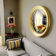 A large convex mirror makes a unique and striking focal point in any interior. Here are some beautiful options for a little inspiration!  #decorativeconvexmirror #largeconvexmirror #convexmirrorlarge Living Room Mirrors, Living Room Decor, Extra Large Round Mirror, Hanging Mirrors, Mirror Above Fireplace, Convex Mirror, New Homes, Interior Design, Mirrors