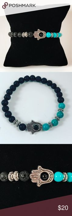 Women beaded bracelet lava rock , turquoise hamsa Women beaded bracelet . Fits most 5.5 to 7 inch wrist. Handmade by me , never worn by anyone. Made with black lava rocks / volcano beads. Turquoise beads . Tibetan silver Hamsa / hand of god / Fatima's hand charm . I ship fast!!✈️ Bundle and save! ( 10 % off bundles) REASONABLE offers considered. Any questions let me know! NO PAYPAL ! Jewelry Bracelets