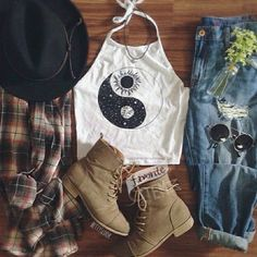 | White Graphic Halter Top | Distressed High Waisted Denim Jeans | Flannel | Light Brown Boots | Black Brim Hat | Circular Sunglasses |