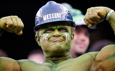 A Seattle Seahawks fan flexes at MetLife Stadium before the NFL Super Bowl XLVIII football game between the Seattle Seahawks and the Denver Broncos