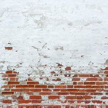 Fotobehang - Sprinkled White Plaster on Red Brick Wall