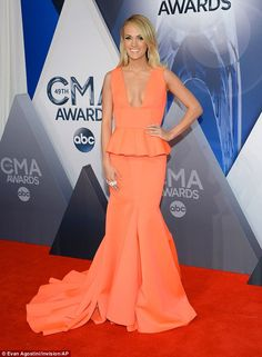Fresh in orange: Carrie Underwood stepped onto the red carpet at the 49th annual Country Music Association Awards on Wednesday evening at the Brookstone Arena in Nashville, Tennessee