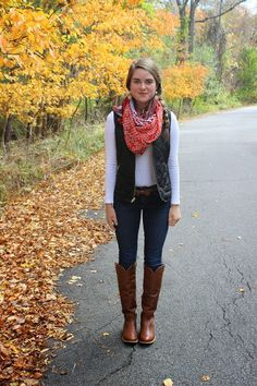 Jeans, brown riding boots, white long sleeve tee, vest, scarf