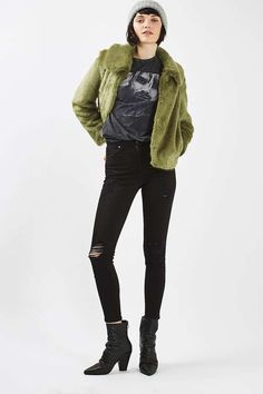 Wrap up in style with this trophy faux fur jacket with collar detail and hook fastening. In an eye-catching green hue, we've styled with ripped jeans and a band tee for an overall quirky-cool look. #Topshop