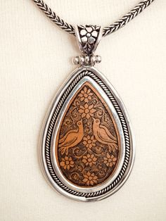 Silver Teardrop Pendant with Carved Gourd Birds