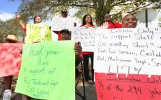 School District officials applaud janitor in midst of union picketing over pay