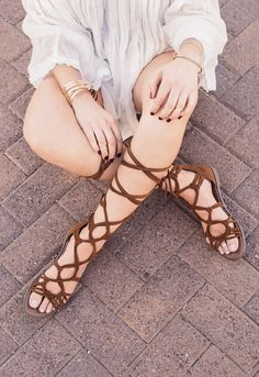 """You'll be saying """"Hello!"""" not """"See ya later!"""" to these Ale Gladiator Sandals in tan! Featuring a faux suede material with adjustable knots and straps that crisscross up the leg for a customized fit. O"""