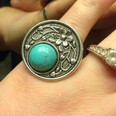Turquoise Ring Cute silver toned ring witH turquoise stone. New without tag. Adjustable Jewelry Rings