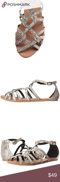 Snake Print Silver Gladiator Sandals The party never ends when you're wearing these sandals! Interlinked vegan leather strappy upper. Adjustable buckle closure at ankle strap. Synthetic lining and footbed. Durable EVA outsole for all-day wear. Imported. Boutique Shoes Sandals
