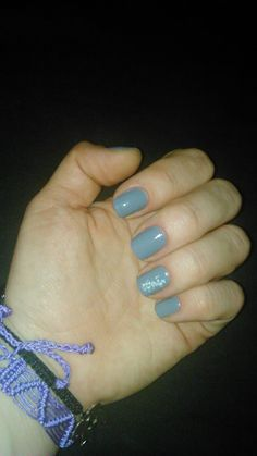 Grey nail lacquer with nail art water decals transfer sticker.