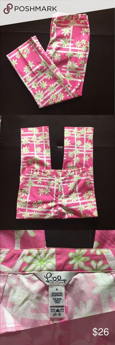 """Lilly Pulitzer Pink Daisy Capris Pink Capris measures 15""""inches across the top, 33"""" inches long with a 23"""" inch inseam. Zip front with one one and one small front pocket. Lilly Pulitzer Pants Capris"""