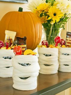 Recycle a soup can: Cover in black paper, glue on wiggly eyes, wrap with gauze to creat Halloween mummy treat tubes