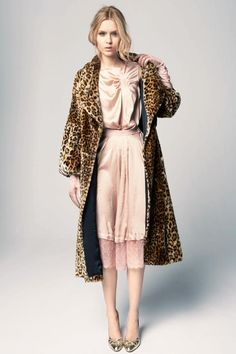 Hurray for animal print, amazing gown. Look at the hem details!   Nina Ricci Pre-Fall 2012