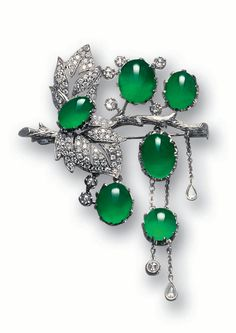 JADEITE AND DIAMOND BROOCH. Designed as a textured branch consisting of two diamond-set leaves supporting six highly translucent jadeite cabochons of emerald green color, highlighted by rose-cut diamonds, the articulated cabochons further suspending tassels of collet-set rose-cut diamonds, mounted in 18 karat blackened gold.