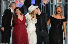 The performers also embraced Queen Latifah onstage during the performance, who acted as officiant