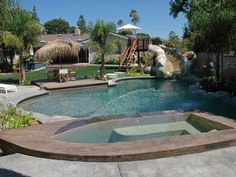 """The homeowners and their children don't have to go far to enjoy a getaway here. Their quarter-acre backyard, designed by Scott Cohen, carries a Robinson Crusoe theme, complete with water slide, pirate's cove, sandy beach, palapa, built-in fire pit, bridge, faux-grass putting green and a """"beached"""" boat/spa. Photo courtesy of Scott Cohen, The Green Scene - I want this is my backyard!"""