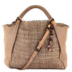 Zambia Cesta  €1,471.00  This is a very precious bag made by our artisans of Vigevano, who's family have mastered their trade over the last century.   The leather, called Intreccio Cesta, is one of our more requested and selled material in the World. Our craftsmen have developed a technical working very special, interweaving each single strip of skin between them. Less close of the Panama one,  the result is a irregular intreccio, with strictly decorative role.  shop @ www.henrybeguelin.it