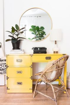 Boho Beach Bungalow - love that yellow campaign desk and that rattan chair.