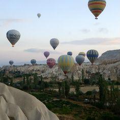 Hot air ballooning in Cappadocia Turkey just after sunrise.