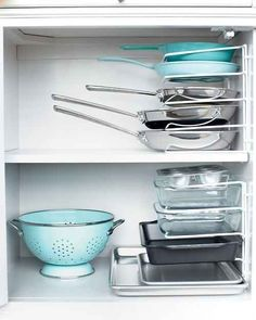 If you have a kitchen, use file dividers to store pans.