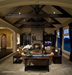 Love the fireplace, beams and windows in this warm great room!  #greatrooms  #greatroomdesigns homechanneltv.com